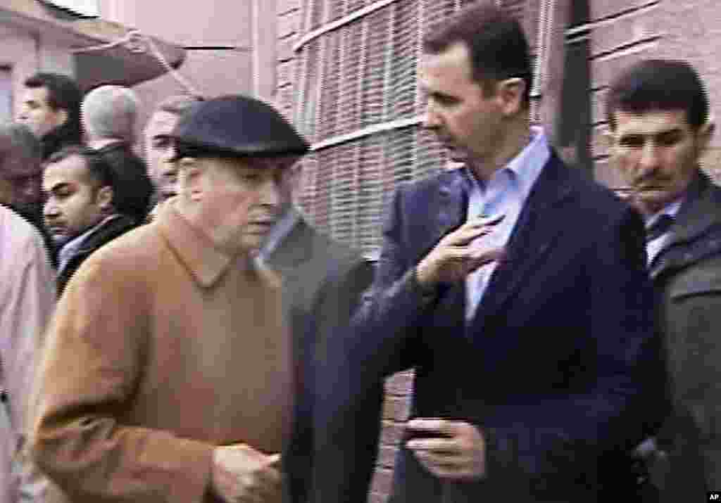 This image made from a video shows Syrian President Bashar al-Assad visiting Baba Amr, Homs, Syria, March 27, 2012. (AP, Syrian State Television)
