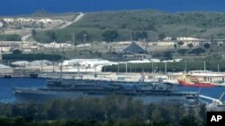 FILE - Navy ships homeported at Naval Station Guam dock at a portion of inner Apra Harbor, seen in this file photo taken May 10, 2005, with the Philippine Sea shown in the background.