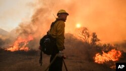 A firefighter watches a wildfire near Placenta Caynon Road in Santa Clarita, California, July 24, 2016.