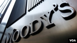 A Moody's sign on the 7 World Trade Center tower is photographed in New York August 2, 2011. Behind all too many of market moves in government debt of late has been a report from one of the major credit ratings agencies. Standard & Poor's is the biggest