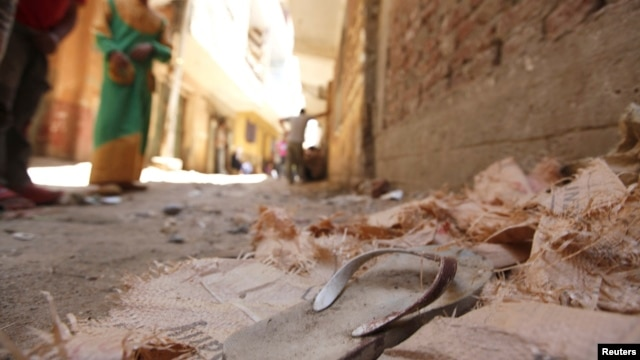 A blood-stained sandal is seen in front of a house, where four Egyptian Shi'ites were killed, in the suburb of Zawiyat Abu Musallem, on the outskirts of Cairo, June 24, 2013.