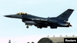 A U.S. Air Force F-16 fighter takes off from the Aviano airbase, Italy, in this 1994 file photo.