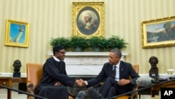 President Barack Obama, right, meets with Nigerian President Muhammadu Buhari, in the Oval Office of the White House, on Monday, July 20, 2015, in Washington. Buhari is seeking to shore up relations between the two countries and to request additional assi