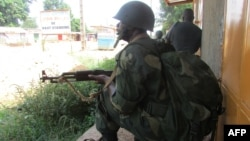 African Union intervention force (MISCA) secures the area during an operation to free the way leading to the north of Bangui on March 25, 2014.