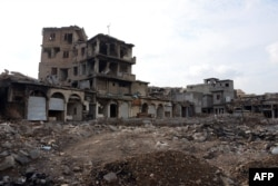 """A picture taken Nov. 7, 2018, shows damaged buildings in Mosul, Iraq. Iraqi forces announced the """"liberation"""" of the country's second city in July 2017, after a bloody nine-month offensive to end the Islamic State group's three-year rule there."""
