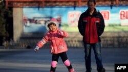 A girl roller-skates at a park in Beijing, Dec. 28, 2013.