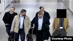 Alleged Russians operatives who later were found attempting to hack into computer networks in the Netherlands arrive at Amsterdam's Schipol Airport. (Source - Netherlands Defense Ministry via U.S. Department of Justice)