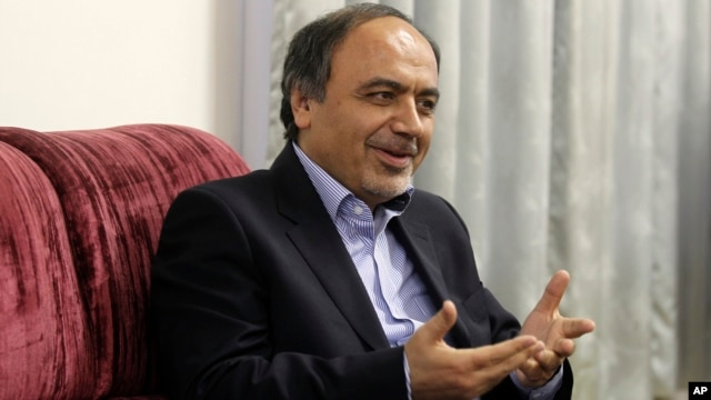 FILE - Hamid Aboutalebi, an Iranian diplomat, who was recently named as Iran's ambassador at the United Nations, speaks at his office in Tehran, Iran.
