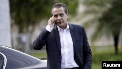 FILE - Brazilian Minister of Tourism Henrique Alves, pictured in December 2015 in Brasilia, is the third minister to resign in a month in connection with the Petrobras graft probe.