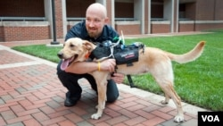 Researchers at N.C. State University have developed a high-tech harness that is equipped with a suite of technologies to enhance communication between dogs and humans. (Credit: North Carolina State University)