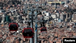 Cable cars travel over La Paz, Bolivia, July 23, 2015. Bolivia has the largest urban cable car system in the world.