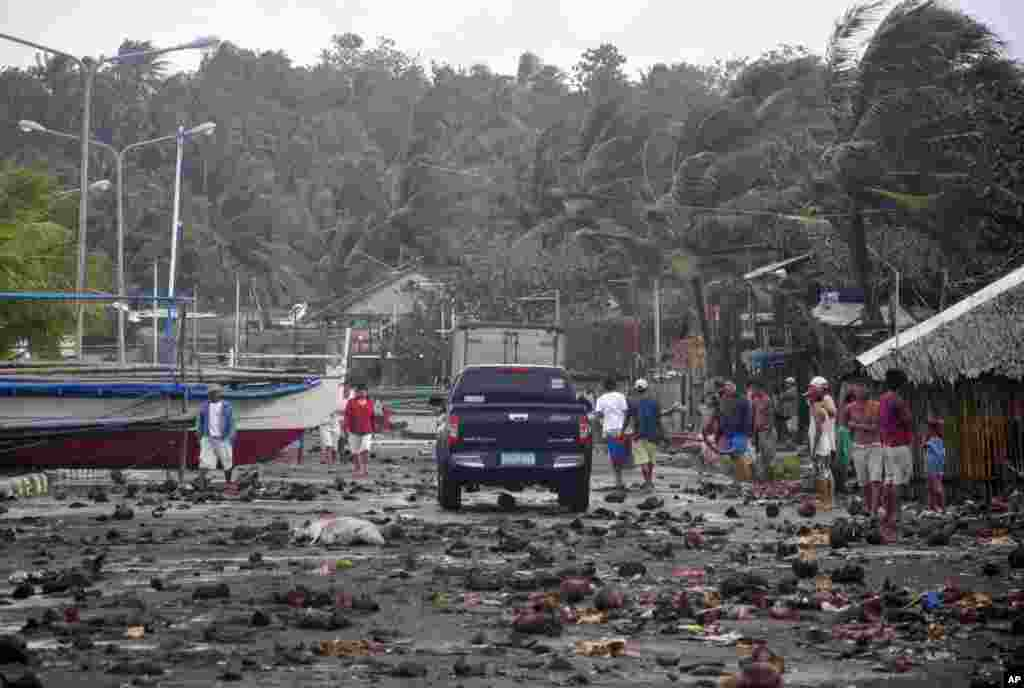 Debris litters the road by the coastal village in Legazpi city following a storm surge brought about by Typhoon Haiyan in Albay province, Philippines, Nov. 8, 2013.