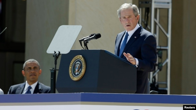 Former U.S. President George W. Bush addresses the dedication of the George W. Bush Presidential Center as U.S. President Barack Obama (L) listens during the ceremony on the campus of Southern Methodist University in Dallas, Texas, April 25, 2013.
