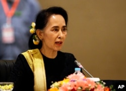 FILE - Myanmar's State Counsellor Aung San Suu Kyi speaks to members of the Union Peace Dialogue Joint Committee (UPDJC) on its ninth meeting at a hotel in Naypyitaw, Myanmar, Feb. 6. 2017. Suu Kyi and her administration made a peace process to end almost