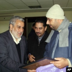 Abdelilah Benkirane (L), the new Head of Government, with two PJD delegates from Agadir (file photo).