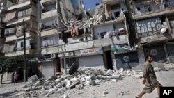 Nhà cửa trong thành phố Aleppo của Syria đổ nát sau một vụ oanh kích