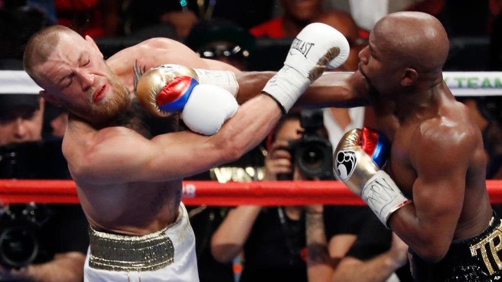 Një ndeshje e fortë boksi: Mayweather mund McGregorin