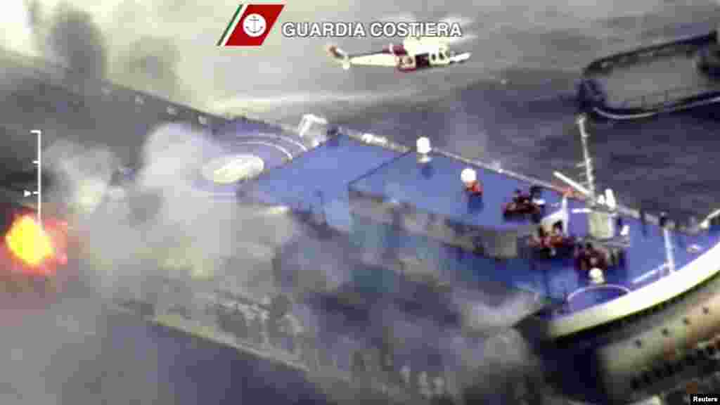 The car ferry Norman Atlantic burns in waters off Greece in this handout video grab of the Italian Coast Guard, December 28, 2014.