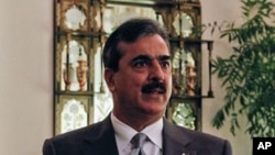 Pakistan's Prime Minister Yusuf Raza Gilani speaks during an interview with Reuters at his residence in Islamabad, Pakistan, September 27, 2011.