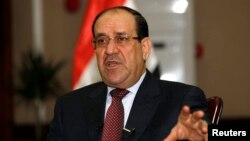 Iraq's Prime Minister Nuri al-Maliki speaks during an interview with Reuters in Baghdad, Jan. 12, 2014.