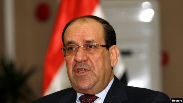 FILE - Iraq's Prime Minister Nuri al-Maliki speaks during an interview with Reuters in Baghdad, Jan. 12, 2014.