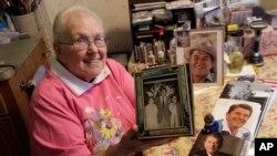 FILE - Former Ronald Reagan International Fan Club president Zelda Multz, 89, poses for photos with Reagan memorabilia in her apartment in the Brooklyn borough of New York, April 1, 2016.
