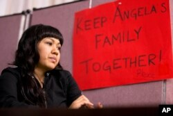 FILE - Angela Navarro, who has been living in the U.S. with her American-born children despite a deportation order issued 10 years ago, sits at the West Kensington Ministry church in Philadelphia, Dec. 8, 2014. Navarro took sanctuary with her children and husband, a U.S. citizen, in the Philadelphia church to help her avoid being deported to her native Honduras.