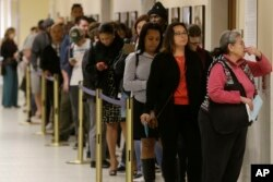 Voters line up at the Department of Elections at San Francisco's City Hall, June 7, 2016. California's changing demographics are aiding Democrats including Kamala Harris and Loretta Sanchez, competing for a U.S. Senate seat in November's election.