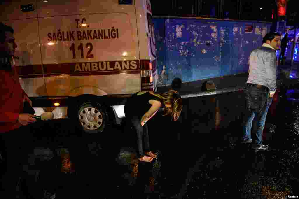 People flee from a nightclub where a gun attack took place during a New Year party in Istanbul, Jan. 1, 2017.