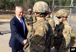 Defense Secretary Jim Mattis greets soliders at Fort Bragg, North Carolina, Dec. 22, 2017.