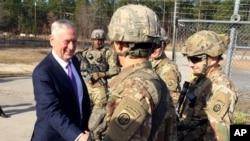FILE - Defense Secretary Jim Mattis greets soliders at Fort Bragg, N.C, Dec. 22, 2017.