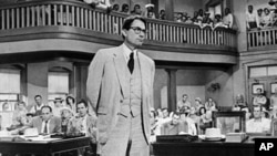 "A scene from the 1962 film version of ""To Kill a Mockingbird."" Actor Gregory Peck won an Oscar for his role as Atticus Finch."