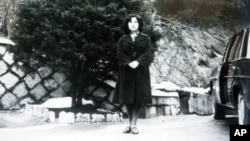 In this undated photo released Nov. 17, 2004, by the Tokyo-based National Association for the Rescue of Japanese Kidnapped by North Korea, Megumi Yokota stands by a car at an unknown place in North Korea after her abduction from her hometown in Japan.