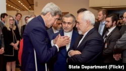 U.S. Secretary of State John Kerry speaks with Hossein Fereydoun, the brother of Iranian President Hassan Rouhani, and Iranian Foreign Minister Javad Zarif, in Vienna, Austria, July 14, 2015.