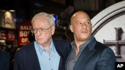 "Sir Michael Caine and Vin Diesel pose for photographers upon arrival at the premiere of ""The Last Witch Hunter"" in London, Oct. 19, 2015."