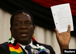 FILE - Zimbabwe President Emmerson Mnangagwa announces the date for the general elections in Harare, Zimbabwe, May 30, 2018.