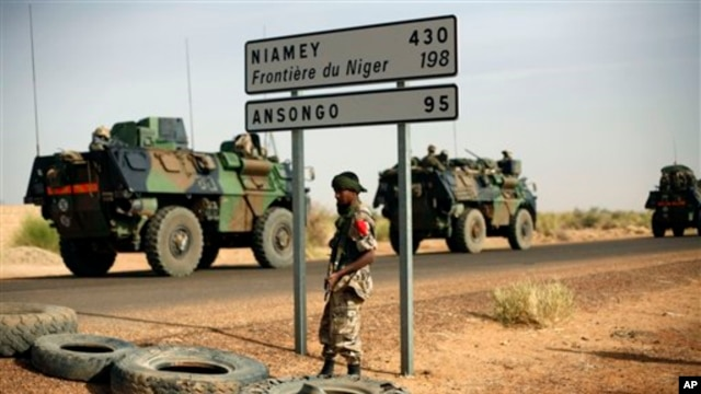 French armored vehicles  are seen heading towards the Niger border before making a left turn north in Gao, northern Mali,  Feb. 6, 2013