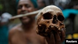 A farmer from Tamil Nadu state shows a skull, who he says are the remains of a Tamil farmer who took his own life. The living farmer is at a protest demanding good rates for their crops among other things in New Delhi, India on July 17, 2017.
