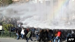 Turkish riot police use water cannon to disperse protesters outside the Supreme Electoral Council (YSK) in Ankara, April 1, 2014.