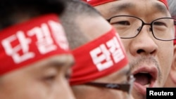 FILE - Han Sang-gyun (R) speaks at a protest in Pyeongtaek, about 70 km (43 miles) south of Seoul.