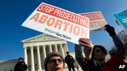 FILE - Abortion-rights activists protest outside the U.S. Supreme Court, during the March for Life in Washington, Jan. 18, 2019.