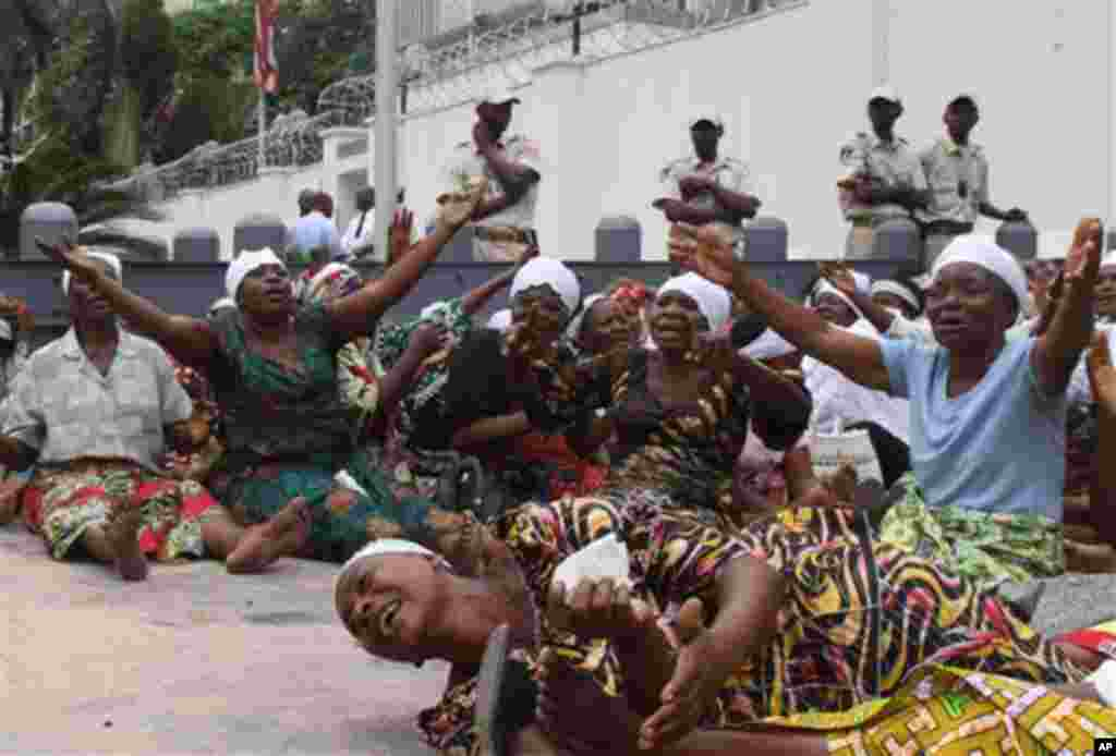 In this Monday, Dec. 19, 2011 photo, women supporters of opposition leader Etienne Tshisekedi protest the results of Congo's recent presidential election outside the United States embassy in Kinshasa, Congo. Incumbent president Joseph Kabila, who was swor