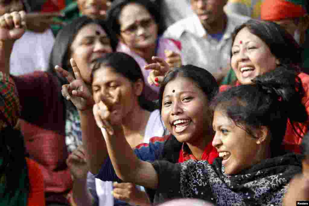 People celebrate after the Supreme Court rejected Abdul Quader Mollah's request for an appeal against his death sentence in Dhaka, Dec. 12, 2013.