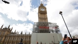 Scaffolding is erected around the Elizabeth Tower, which includes the landmark 'Big Ben' clock, as part of ongoing conservation efforts at the Palace of Westminster in London , Aug. 3, 2017.