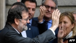 Spanish out-going Prime Minister Mariano Rajoy leaves after a vote on a no-confidence motion at the Lower House of the Spanish Parliament in Madrid