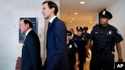 White House senior adviser Jared Kushner, center, and his attorney Abbe Lowell, left, arrive on Capitol Hill in Washington, July 25, 2017, to be questioned by the House Intelligence Committee.