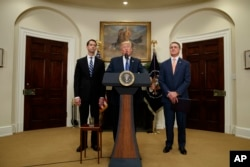 President Donald Trump, flanked by Sen. Tom Cotton, R- Ark., left, and Sen. David Perdue, R-Ga., speaks in the Roosevelt Room of the White House in Washington, Aug. 2, 2017, during the unveiling of legislation that would place new limits on legal immigrats.