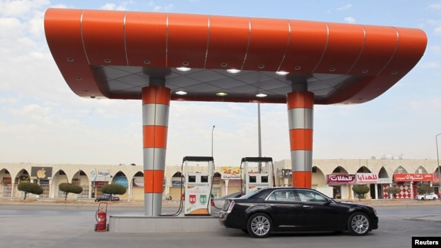 FILE - A driver waits to fill his car with fuel at a gas station in Riyadh, Saudi Arabia, Dec. 22, 2015.