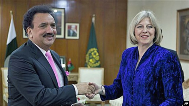 Visiting British Home Secretary Theresa May exchanges copies of agreements regarding bilateral issues - including cooperation in the war against terrorism - with Pakistan's Interior Minister Rehman Malik in Islamabad, Pakistan, Oct 26, 2010 (File Photo)