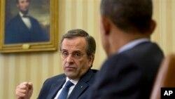 Presiden Barack Obama (kanan) dan Perdana Menteri Antonis Samaras bertemu di Ruang Oval Gedung Putih pekan lalu (8/8).